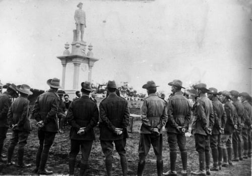Returned soldiers in uniform surrounding the Digger War Memorial in Chinchilla ca. 1920