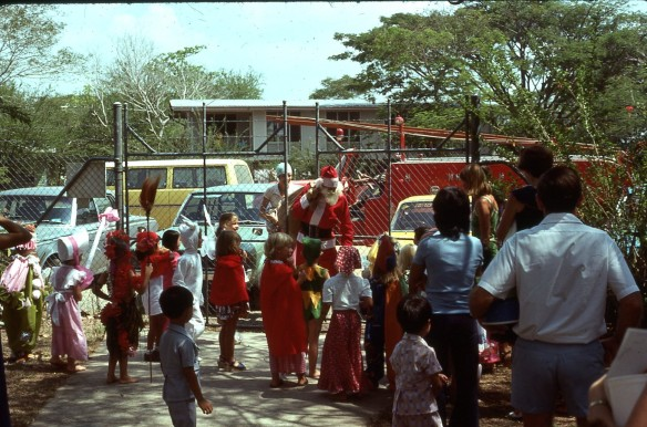 Santa arrives by fire engine at Boroko East Pre-School in Port Moresby 1977.