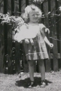 This is a photo from my 3rd birthday with my new doll, Ann.