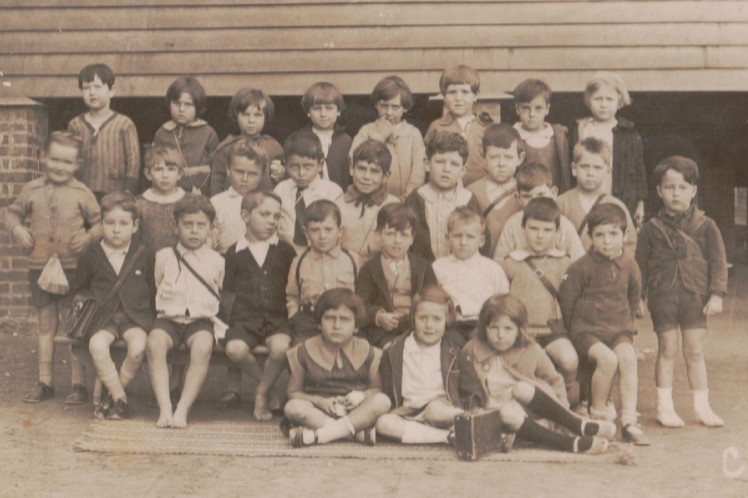 Kelvin Grove State School c1930. My father is in the 2nd back row looking rather pugnacious.
