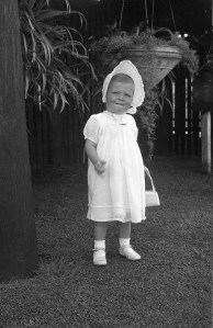 My christening dress. What was my thing with handbags, at this age!