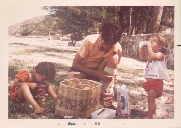 Peter and DD1 and 2 at Ela Beach.