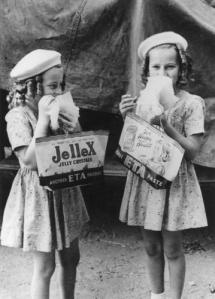 Two young girls enjoying their show bags. Copyright expired, SLQ bishop.slq.qld.gov.au:139717