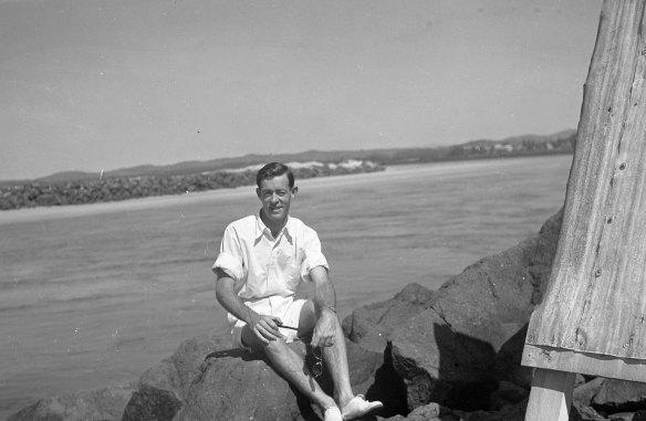 Dad at the beach during my parents' honeymoon, pipe in hand.
