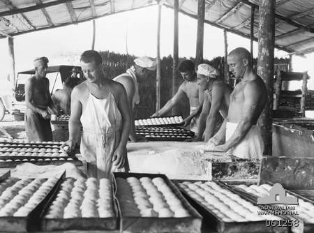 Image 061258 AWM. 4th Field Bakery men preparing bread rolls.