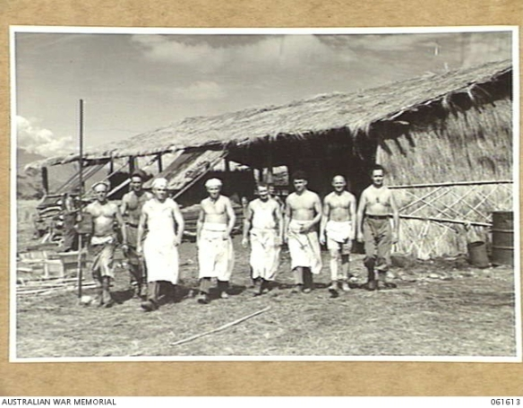 AWM Image 061613 of the 4th Field Bakery men leaving the bush materials bakehouse at Dumpu in the Ramu Valley, PNG.