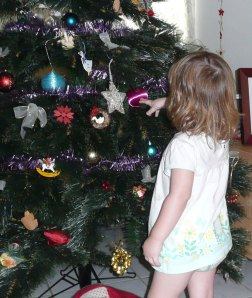 Another generation discovers the Xmas tree -and an original bauble from 1970.