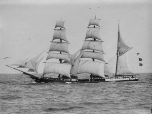 Green, Allan C (1900). [Unidentified barque (sailing ship) in full sail]. Copyright expired.