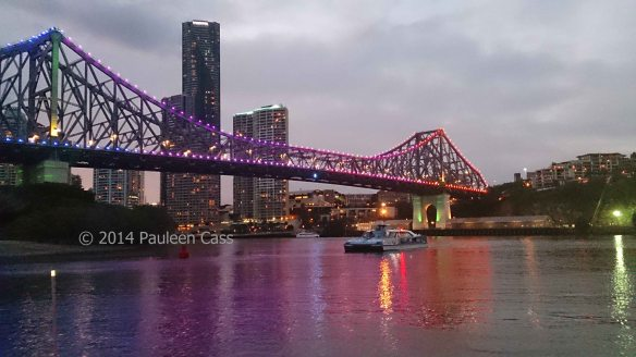 The Story Bridge at sunset, a city cat, and in the distance my school, one of Brisbane's heritage sites.