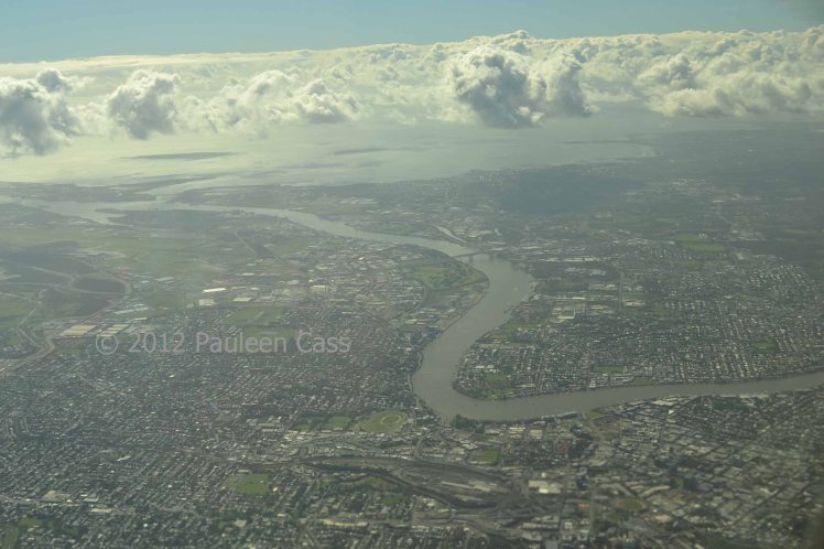 The Brisbane River approaches the city from the west.