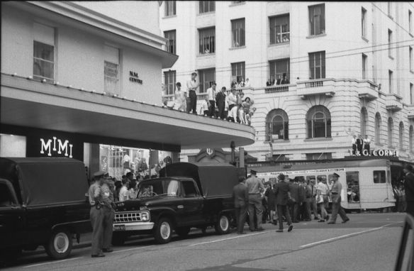 Garner, Grahame Onlookers on buildings during the Youth Campaign against Conscription, Brisbane, Australia. Garner, Grahame, 1966-03-24.