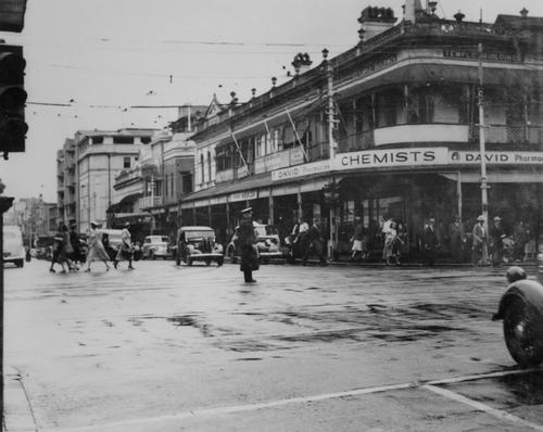 Unidentified (1950). Police officer directing traffic on George Street, Brisbane, 1950. John Oxley Library, State Library of Queensland