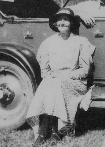 This is Bridget Connors sitting on the running board of her car. I can imagine her with the same contented expression sitting by the pond fishing.