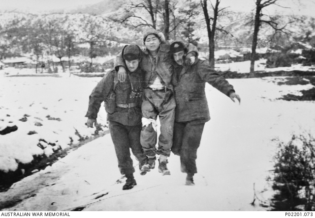 wo members of the 3rd Battalion, The Royal Australian Regiment (3RAR), carry a wounded soldier from the Republic of Korea (ROK) Army along a snow-covered track towards a medical aid post. http://trove.nla.gov.au/work/165106038