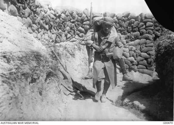 French soldier carrying a wounded man through the trenches, Gallipoli http://trove.nla.gov.au/work/165156560