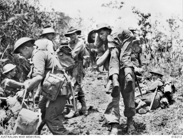 Australian troops moved in behind Matilda tanks for a dawn attack on the Japanese held village of Sattelberg. A wounded soldier is carried back to a dressing station on the shoulders of a soldier. http://trove.nla.gov.au/work/165056323