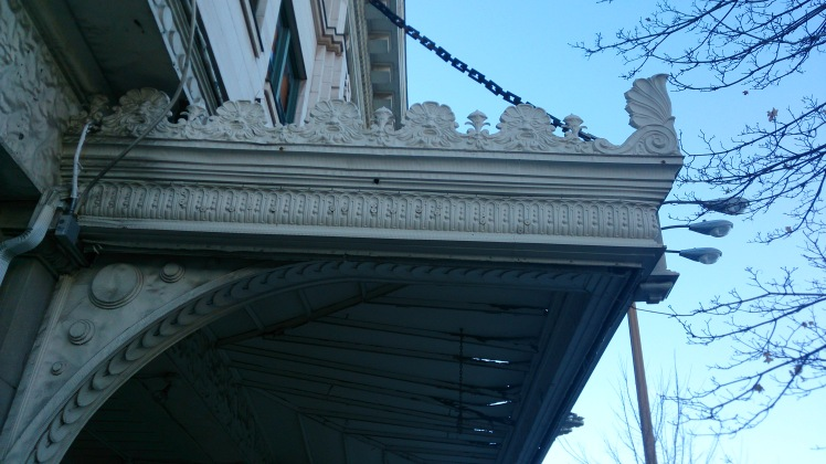 Check out the faces framing the awning.