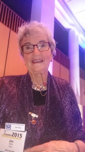 Jan Gow, NZ, proudly displaying her medallion at the dinner.