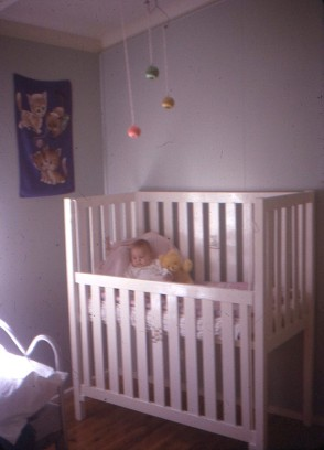 Louisa in her cot and bedroom nth Goroka 1972