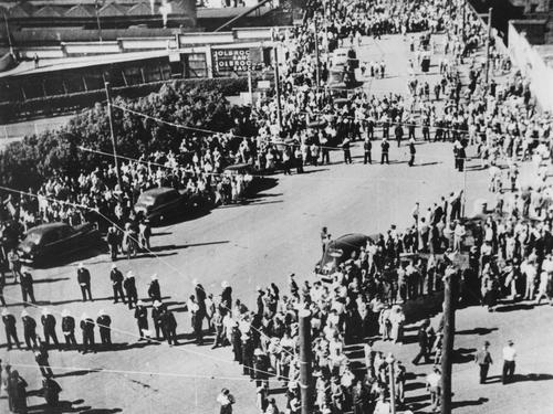 Crowds and police in Edward Street infront of the Trades Hall during the Railways Strike Brisbane 1948