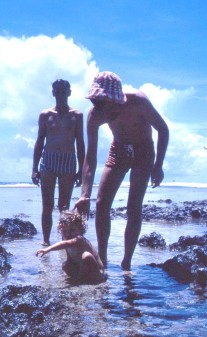 Louisa in rock pools at Wewak with Peter and Les 1973